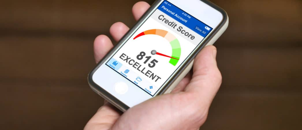 Credit Score for Mortgage being shown on a smartphone being held in a man's hand